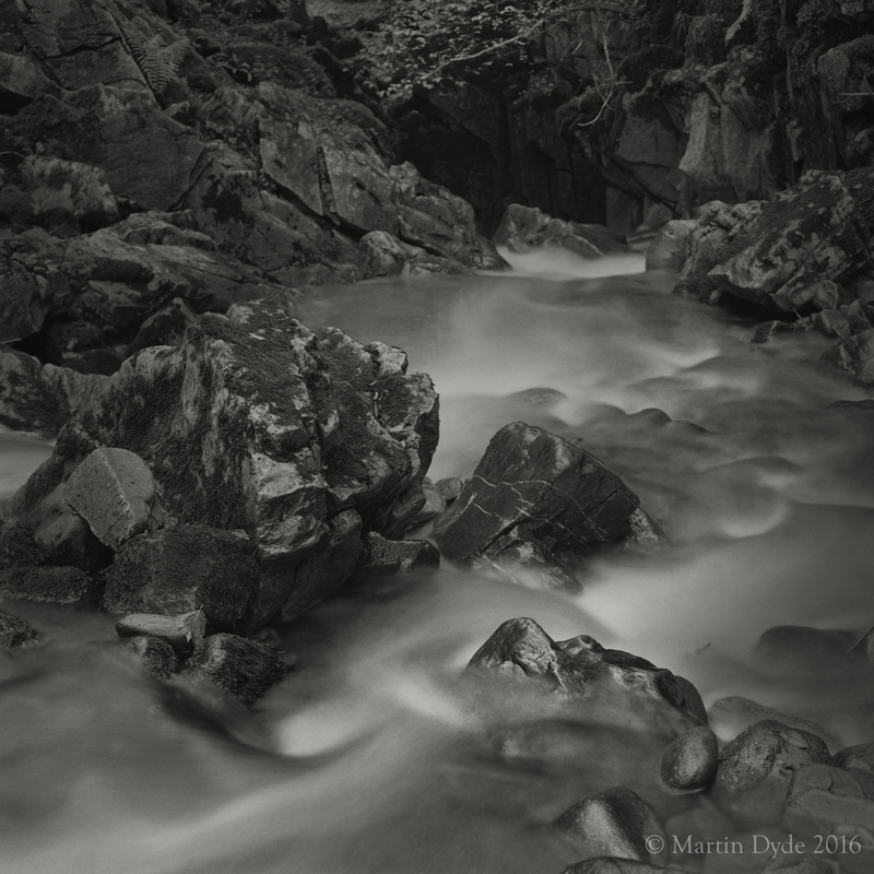 Stream plunging into limestone cave, Cwm Pwll-y-Rhyd, Brecon Beacons, Wales | The Silver Monochrome: black-and-white film photography by Martin Dyde