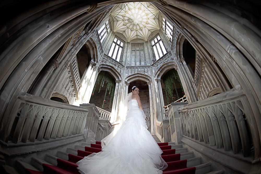 Bride on stairs at Margam Orangery - Wedding Photography at Margam Orangery