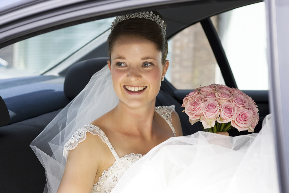 Bride in Wedding car at Caerphilly Castle - Wedding Photography at Caerphilly Castle