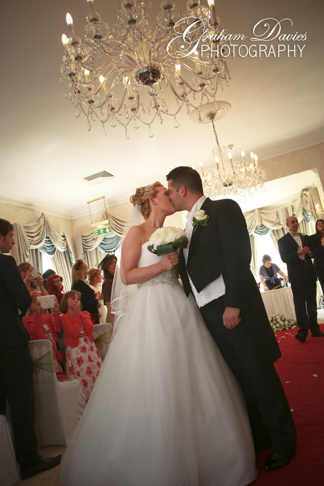 First Kiss Bride & Groom at Wedding Ceremony in De Courceys, Cardiff - Wedding Photography at De Courceys, Cardiff