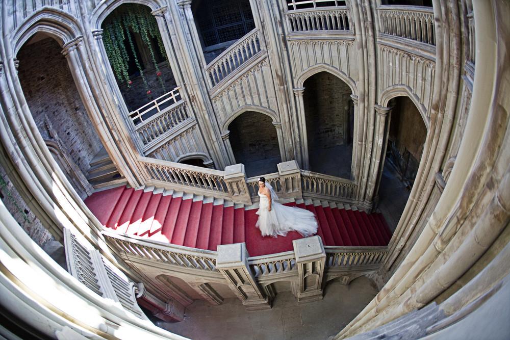 Bride on stairs at Margam Orangery (inside Margam House) - Wedding Photography at Margam Orangery