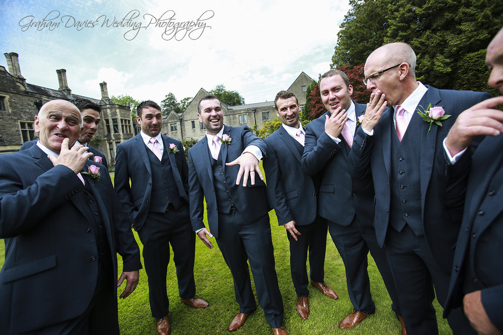 Miskin Manor Groom fun shot with ring - Wedding Photography at Miskin Manor