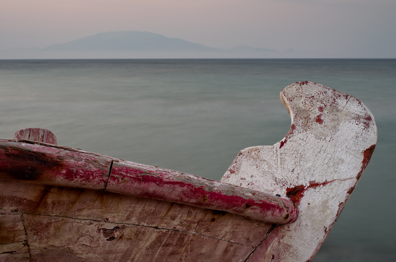 Old wooden fishing boat with peeling paint, Zakynthos, Greece.