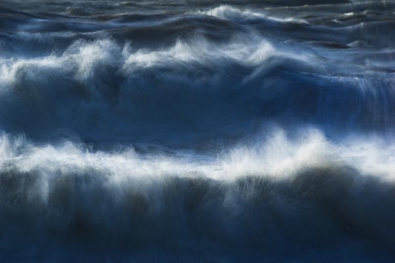 Spindrift off huge breaking waves.