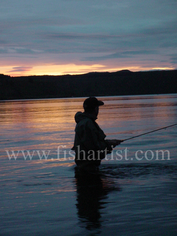Sunset Taupo Fisherman. - Trout Fishing - Taupo New Zealand.