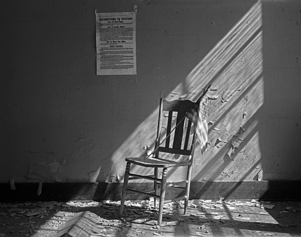 Interior with chair and flag. - Abandoned America