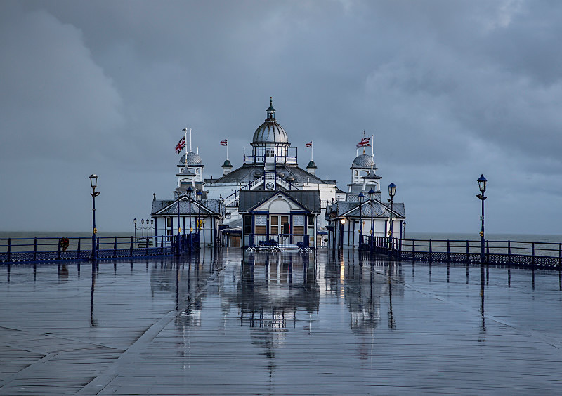 Eastbourne Pier in rain. - Coastal Britain