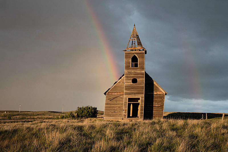 Rainbow over abandoned church, Montana. - Bad Weather
