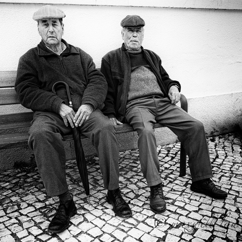 Two men on a bench - Photojournal