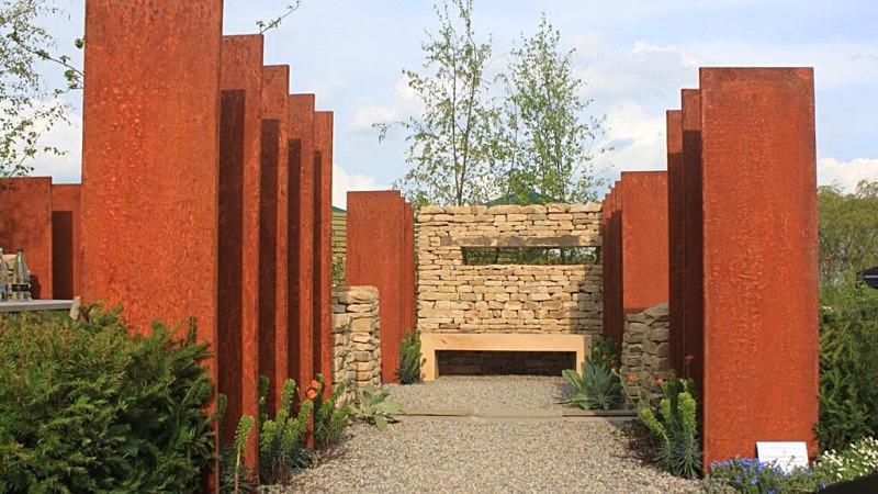 Euphorbia characias 'Black Pearl' - Harrogate Spring Water 'Secret Garden'