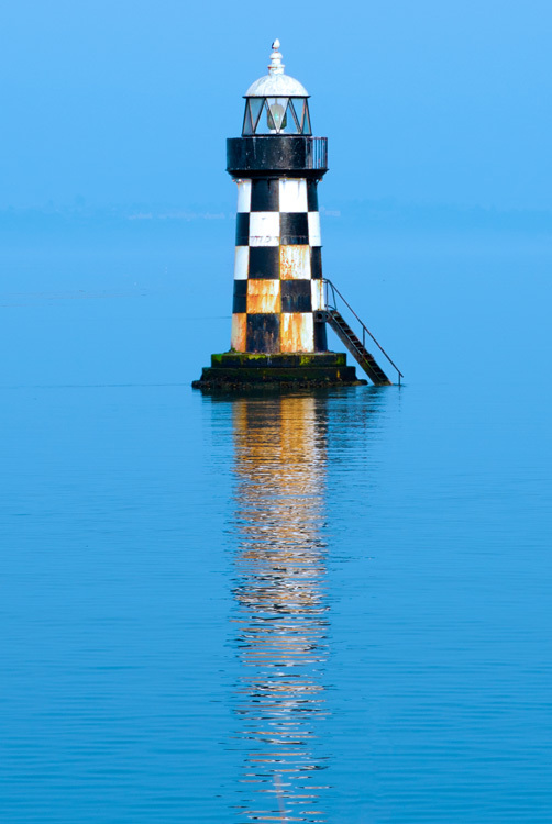 Lighthouse in blue haze - The Colour Project