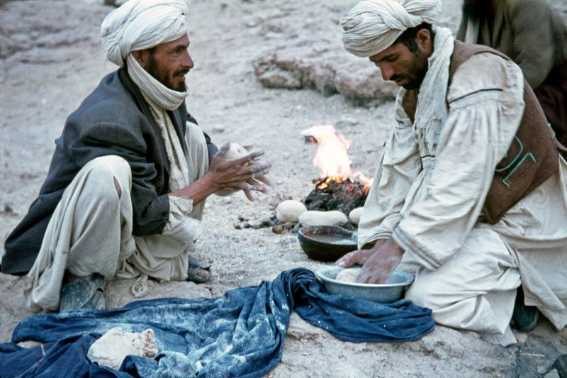 Pathan tribesmen making bread in Afghanistan