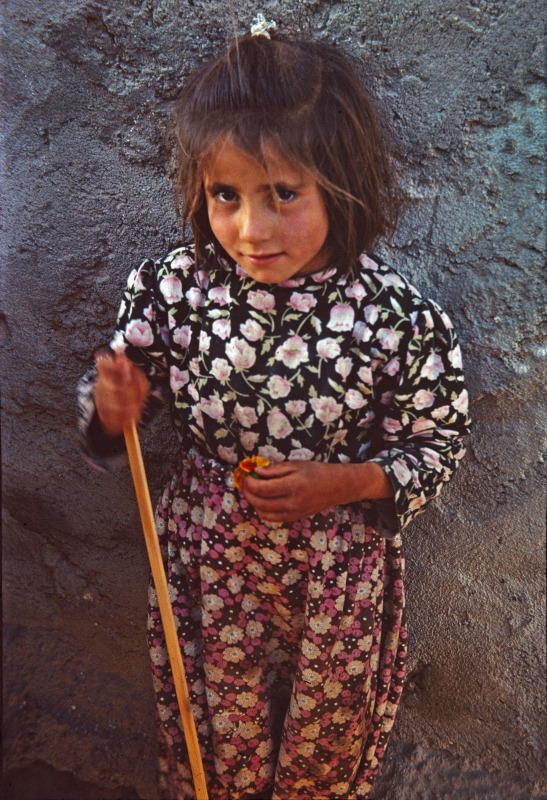 Afghan girl with flower