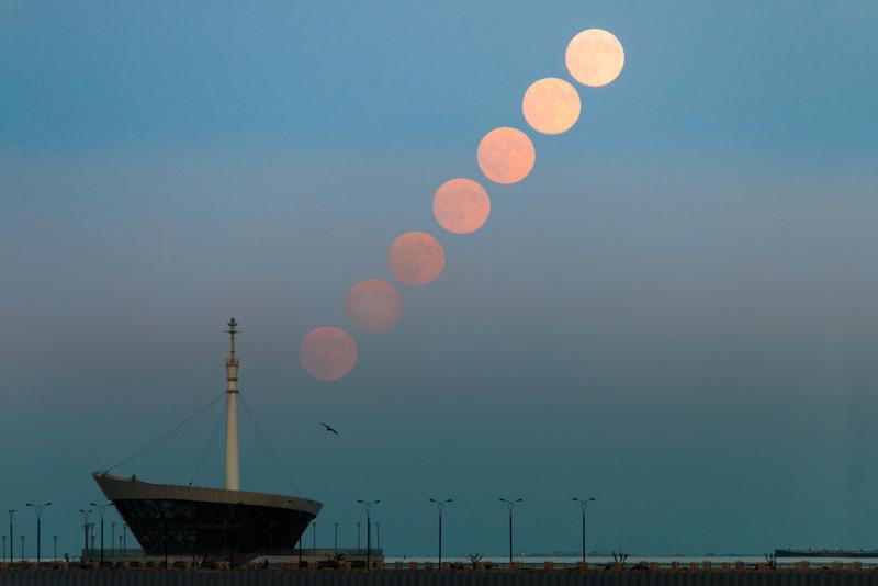 Full moon rising over baku lighthouse