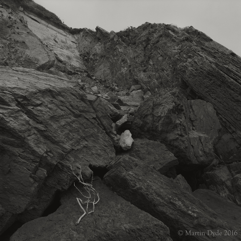 Rockfall and fallen twig, Marloes Sands, Pembrokeshire, Wales | The Silver Monochrome: black-and-white film photography by Martin Dyde