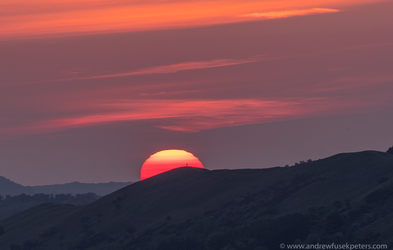 the rising sun and the distant walker - Olympus Landscape