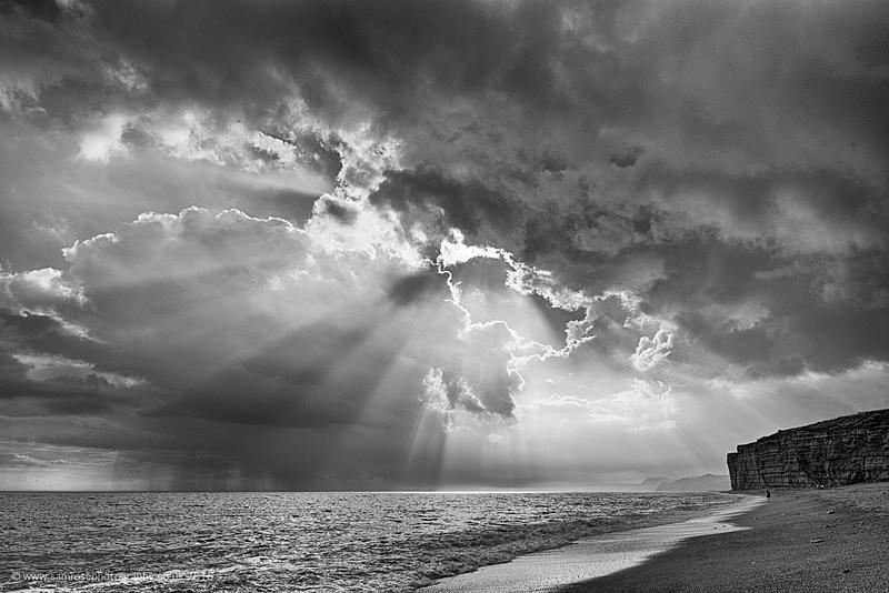 Sun rays over Burton beach - Dorset Photos