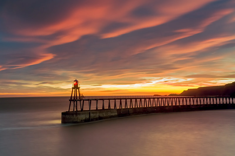 Sun rising behind Whitby's East Pier - North Yorkshire