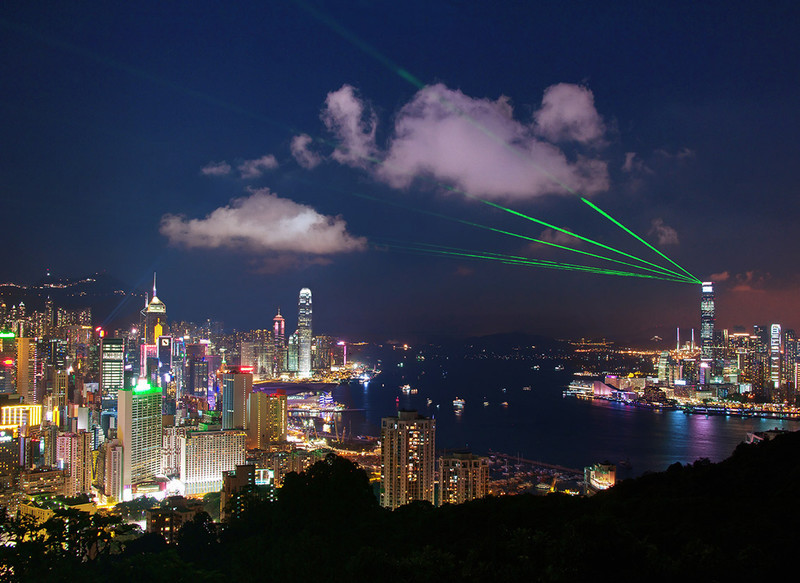 Laser show over the harbour from Braemar Hill - Hong Kong with the Aqua Luna Junk