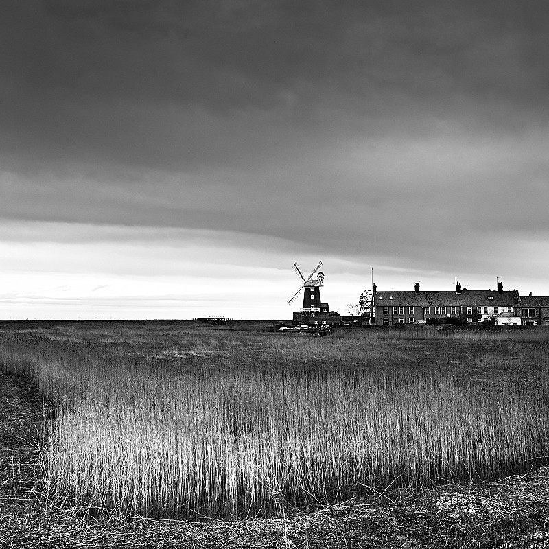 Black and white Norfolk Coast landscape photography of Cley-next-the-Sea windmill