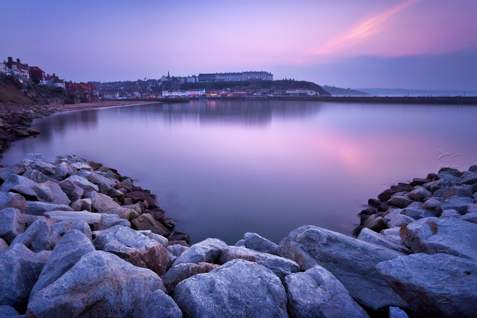 Photograph looking across Whitby bay in the evening light