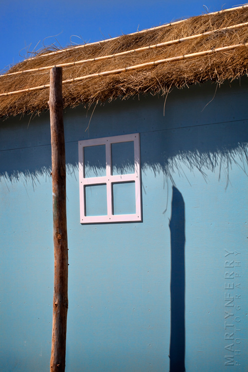 Summer image of pale blue fishing hut
