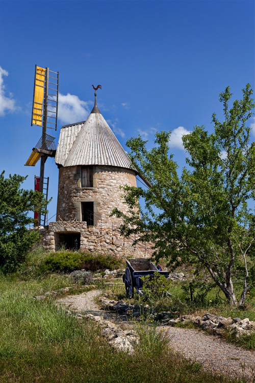 Image of windmill under blue sky