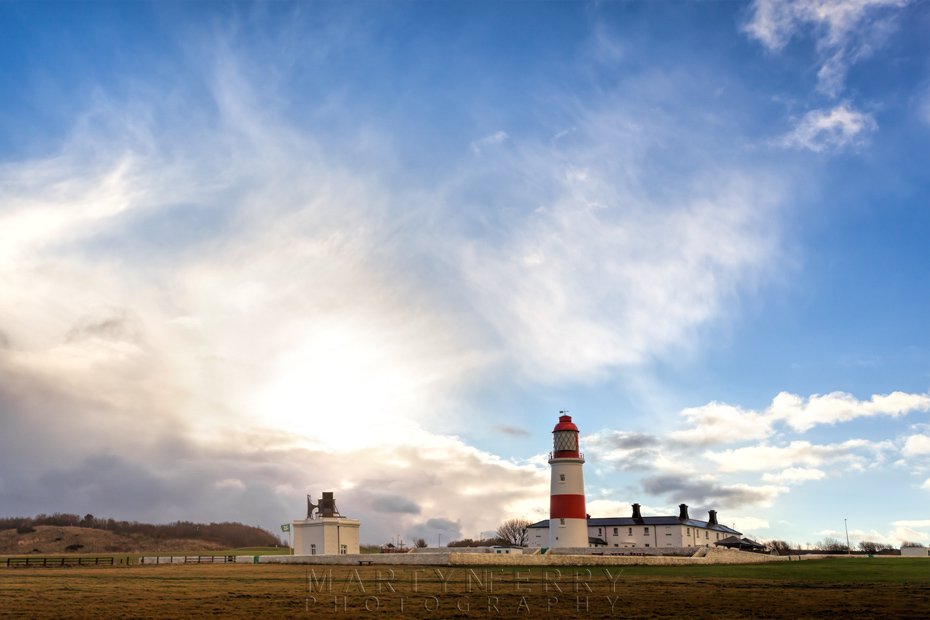 Souter Lighthouse with the sun appearing behind