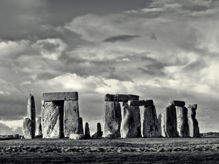 Striking black and white image of Stonehenge in sunlight