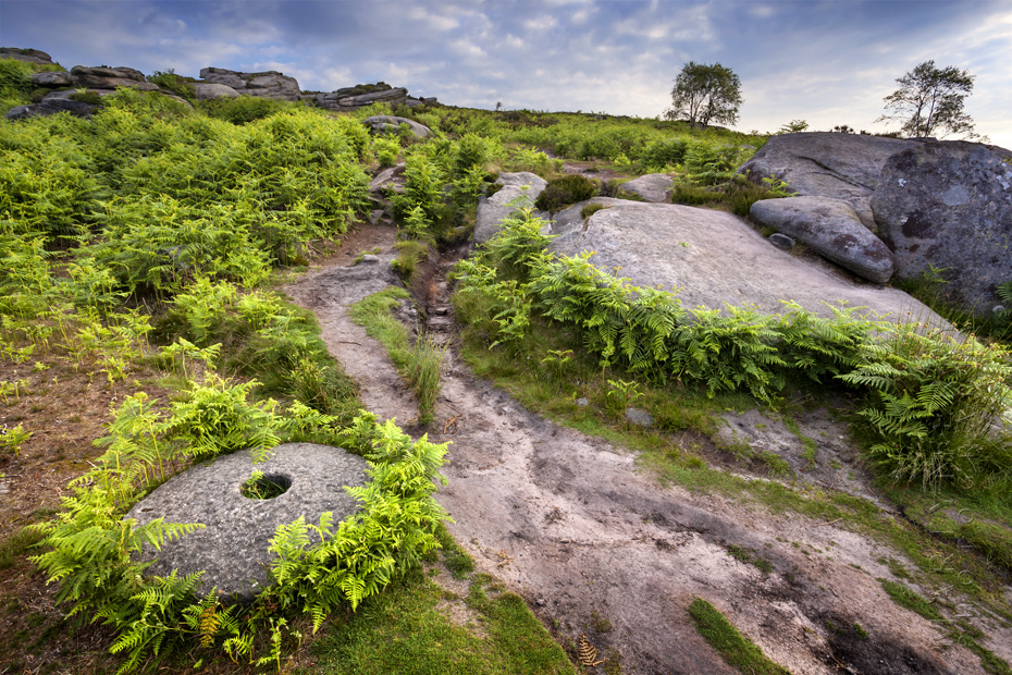 Over Owler Tor pathway photograph with old millstone