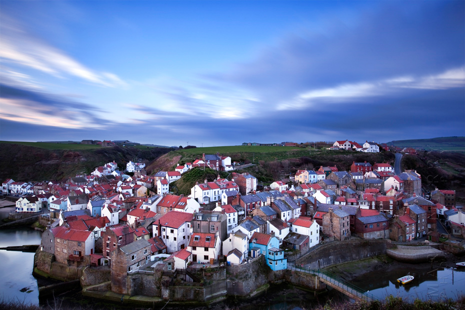 Long exposure photograph of Staithes village at sunrise