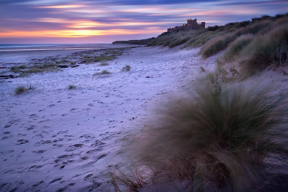 Sunrise colours over Bamburgh Castle in Northumberland