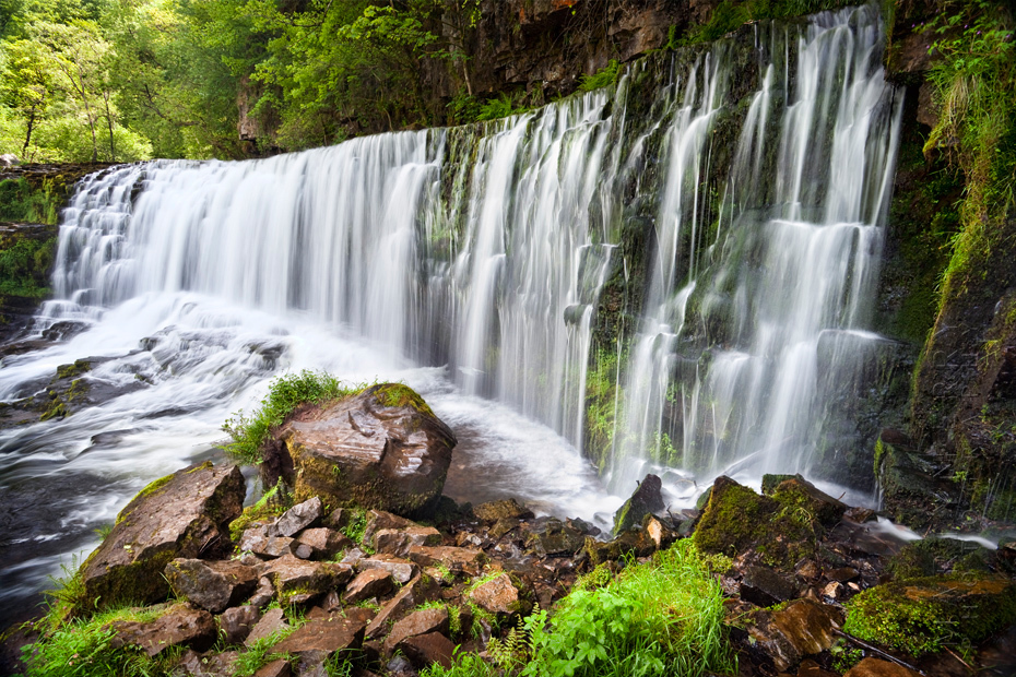 Powerful waterfall in the beautiful woodland of the Brecon Beacons