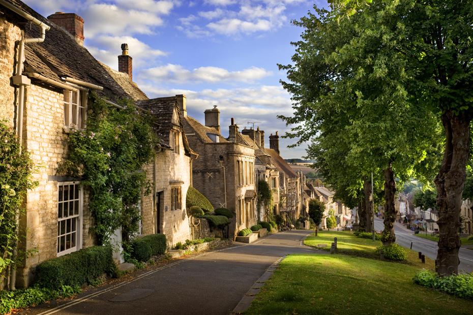 View down Burford High Street in the warm morning sunshine