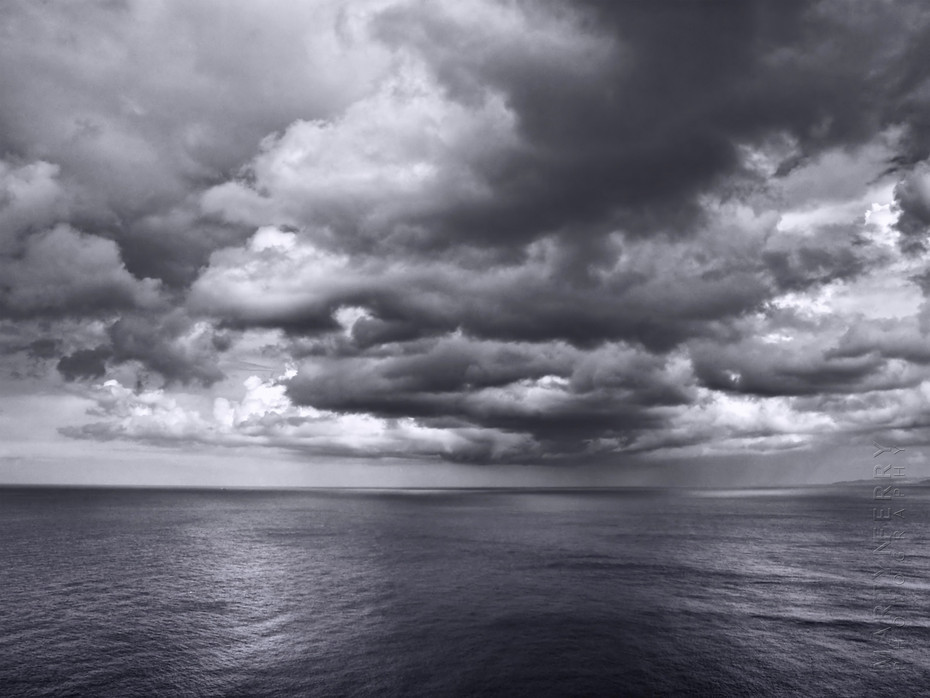 Striking clouds hover over the ocean