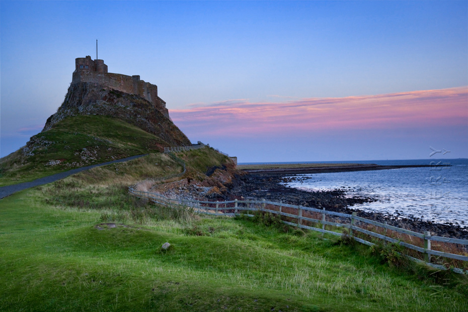 Sunset colour over Lindisfarne Castle in Northumberland