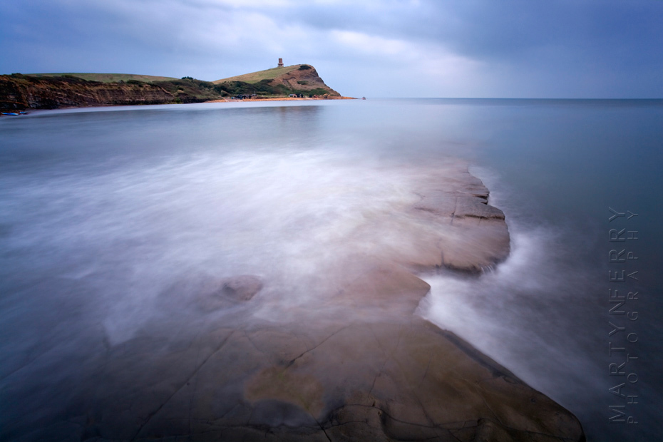 Rock shelves in a blue ocean at Kimmeridge Bay