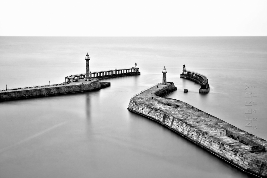 Whitby piers in stunning black and white