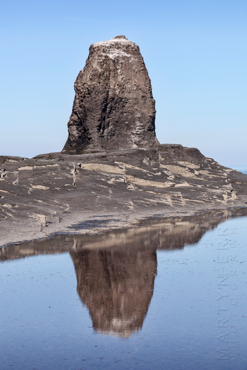 Simple reflection of Black Nab at Saltwick Bay