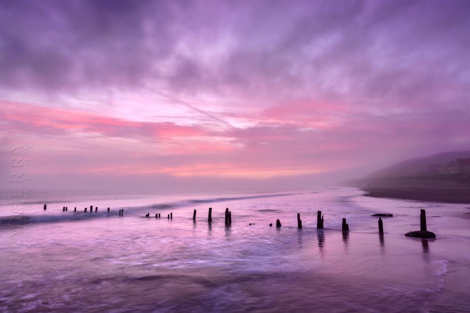 Sandsend beach groynes under a beautiful sunrise sky