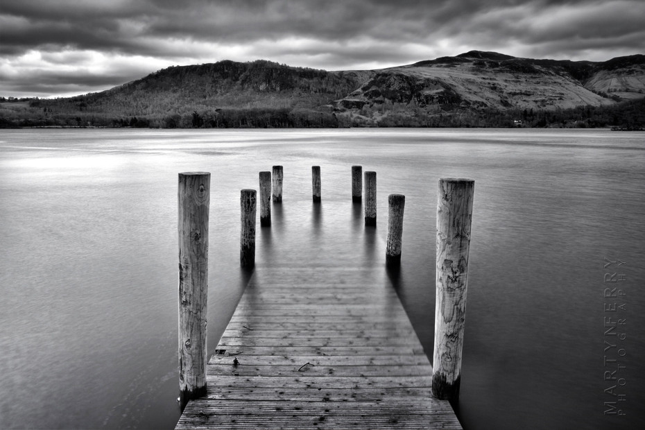 Image of wooden jetty in black and white