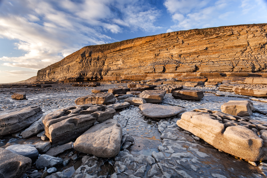 Dunraven Bay cliffs bathed in warm evening sunlight
