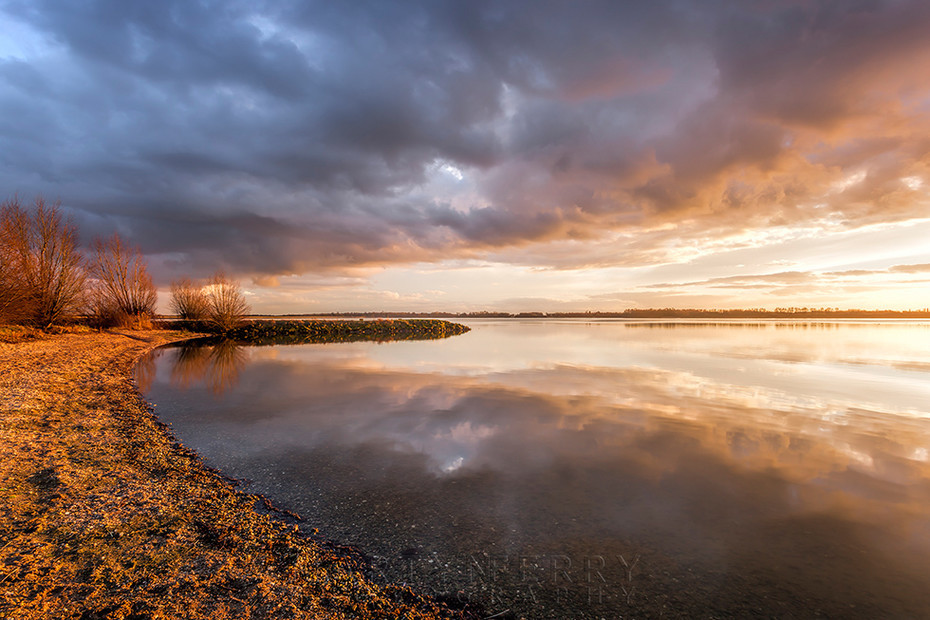 Grafham Water lake shore at sunset