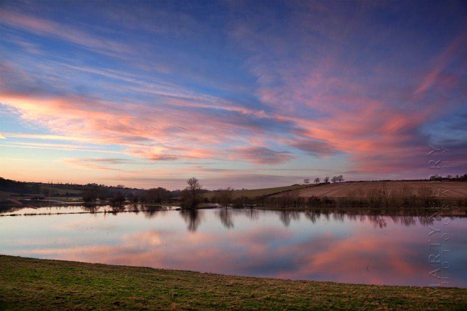 Photograph of the flooded Windrush Valley in the Cotswolds at sunset