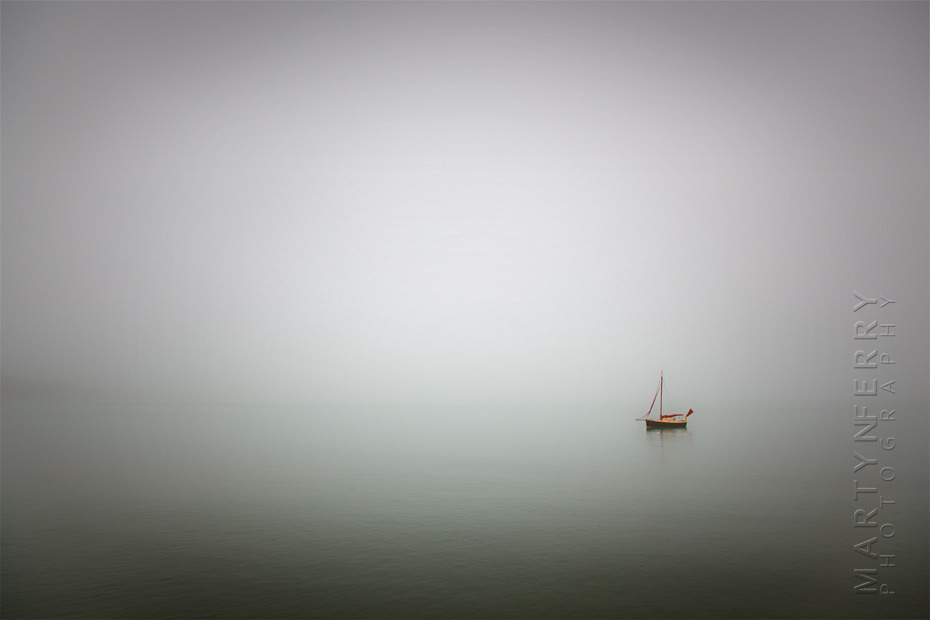 Striking minimal photograph of solitary boat at sea in Dorset