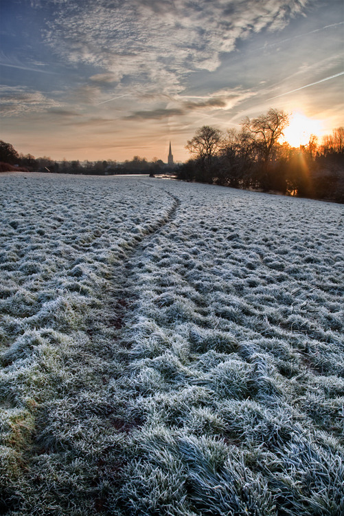Winter image of a frosty path heading towards Burford at sunrise