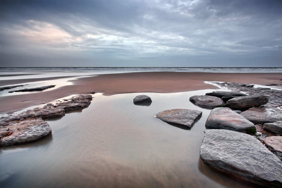 Seascape photograph at Dunraven Beach and stormy skies