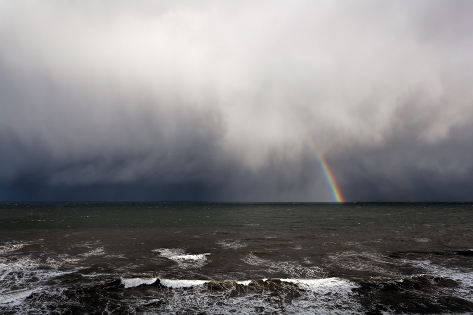 Rainbow and storm clouds over the ocean