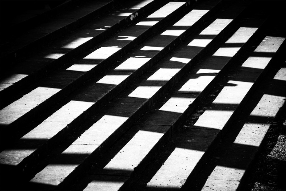 Sunlight casts shadows on steps