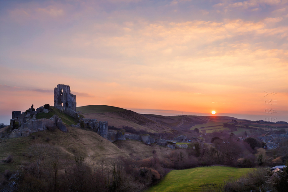 Iconic ruins of Corfe Castle in Dorset at sunrise
